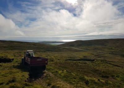 Tractor collecting peat above Bigton